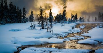 sunset over a steamy snowy river in yellowstone